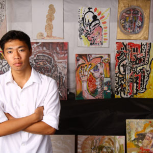 Michael Ho '15 with his work produced at HPA, Upper School