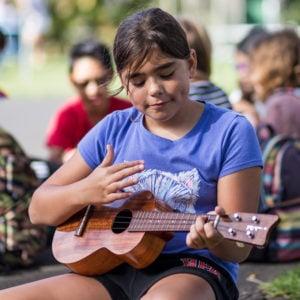 Practicing 'ukulele during recess, Lower School