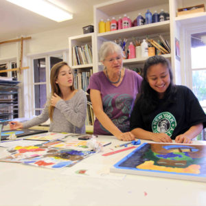 Jane Taylor, Middle School art teacher, with students