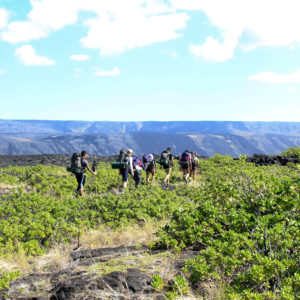 Embarking on a four-day backpacking trip with the 1969 to 1974 Mauna Ulu lava flows in the background. Mau loa o Mauna Ulu, 2019