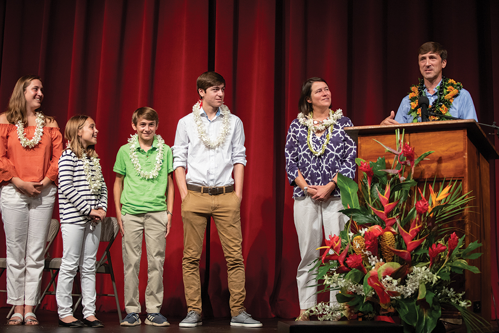 Patrick Phillips introduces the Phillips 'ohana during his installation ceremony in August. From the left: Taylor (a sophomore at Middlebury College), Riley '27, Cooper '24, Grayson '20, and Ainslie Phillips.